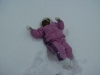 Eden fell over in the snow