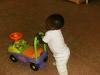 Eden pushing the car