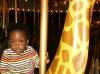 Eden riding Twiga on the merry-go-round
