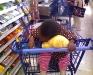 Eden sleeping in shopping cart at Meijer