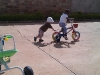 Andy pushing Eden on her bike